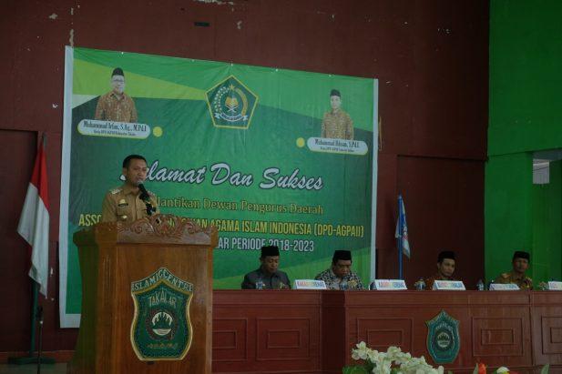Bupati Takalar H Syamsari Kitta memberikan sambutan di pelantikan 40 DPD-AGPAI di Gedung Islamic Center Takalar, Rabu (30/4/2019). (Abdul Kadir. Berita.News)