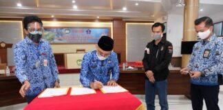 KPU, Gugus tugas penanganan covid dan Dinkes Gowa teken kerjasama. (Foto: Berita.news/Putri)